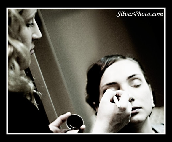 makeup artist  doing makeup on bride