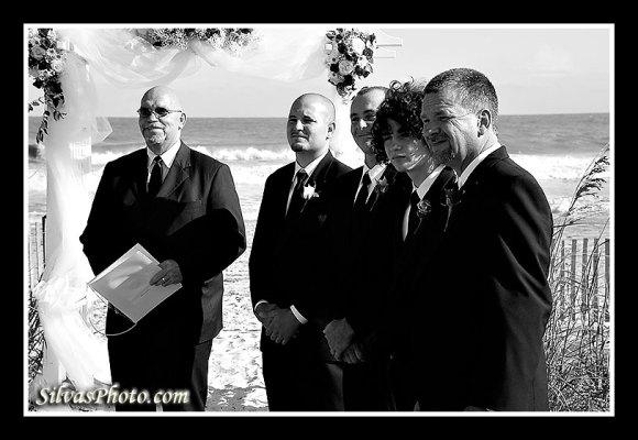 Groomsmen looking at bride