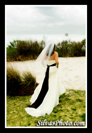 bride at beach in Charleston Harbor Resort and Marina, Mount Pleasant, South Carolina