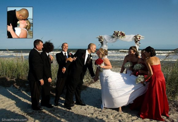 Kiss of Bride and Groom with Bridal Party