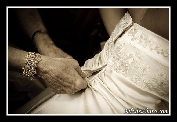 Zipping up the bridal dress